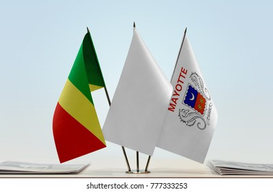 Flags of Republic of the Congo and Mayotte with a white flag in the middle