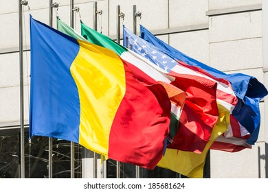 Flags Of Romania, Italy And United States Of America At International Summit In Bucharest
