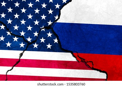 Flags of Russia and USA on cracked wall