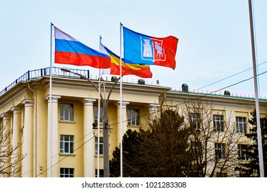 Flags of the Russian Federation, Rostov-on-Don and the Rostov Region flutter in the wind high above the ground