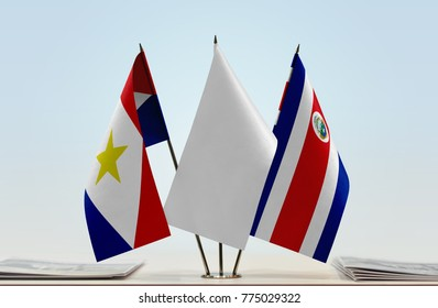 Flags of Saba and Costa Rica with a white flag in the middle