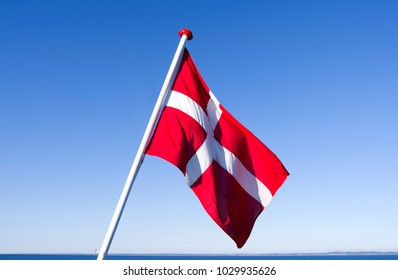 Flags / Seafaring / Denmark: The Danish national flag Dannebrog is fluttering in the wind at the stern of a small ferryboat crossing the Kattegat Sea