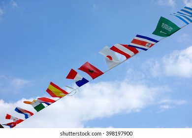 Flags of several nations waving in the sky