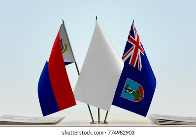 Flags of Sint Maarten and Montserrat with a white flag in the middle