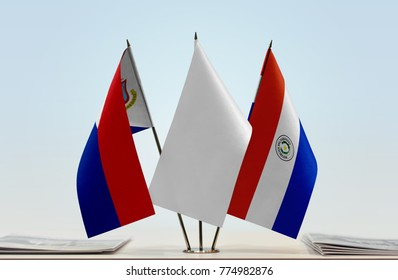 Flags of Sint Maarten and Paraguay with a white flag in the middle
