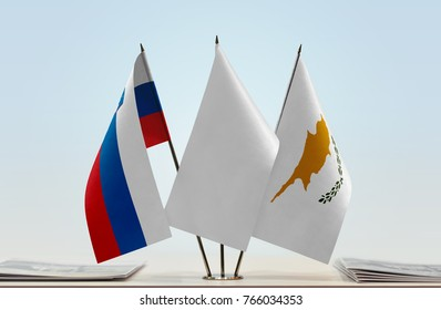 Flags of Slovenia and Cyprus with a white flag in the middle