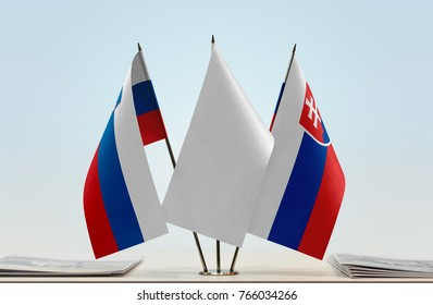 Flags of Slovenia and Slovakia with a white flag in the middle