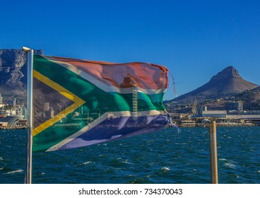 The flags of South Africa is blowing in the Wind in front of the Table Mountain in Cape Town in South Africa