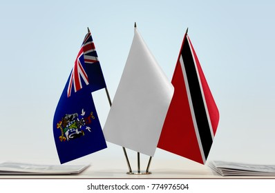 Flags of South Georgia and South Sandwich Islands and Trinidad and Tobago with a white flag in the middle