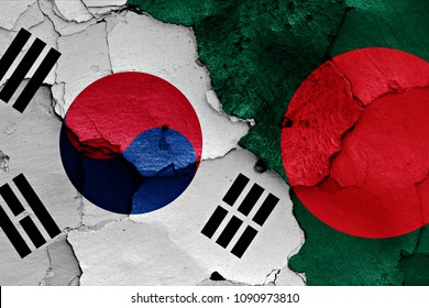 flags of South Korea and Bangladesh painted on cracked wall
