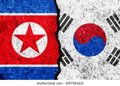 Flags of South Korea and North Korea painted on cracked wall background/South Korea versus North Korea conflict concept