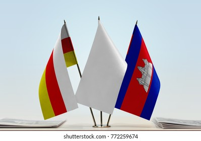 Flags of South Ossetia and Cambodia with a white flag in the middle