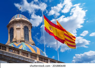 Flags of Spain and Catalonia Together / Detail of Palau de la generalitat de Catalunya in Barcelona, Spain with Spanish and Catalan flag waving in the wind
