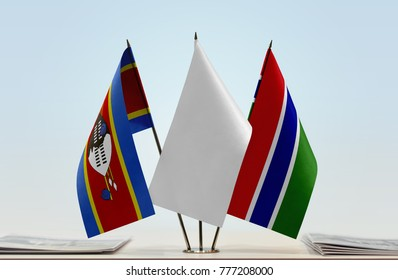 Flags of Swaziland and The Gambia with a white flag in the middle