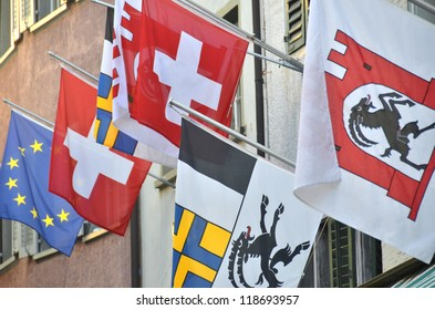 Flags of Switzerland, the canton of Graubunden, and Europe