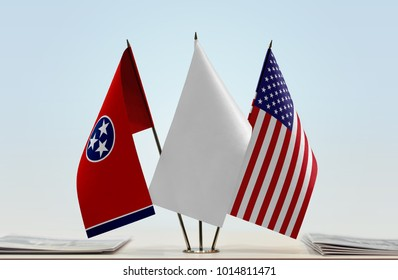 Flags of Tennessee and USA with a white flag in the middle
