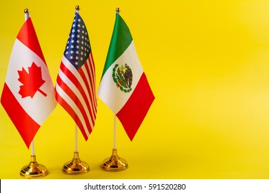 Flags of the three countries of Canada, Mexico and United States of America.