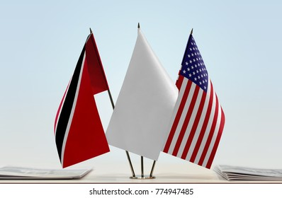 Flags of Trinidad and Tobago and USA with a white flag in the middle