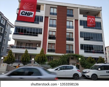 Flags of two major parties(CHP and MHP) on a civil apartment building in Turkey. Showing propoganda for the elections to be held on 31 March 2019. image taken 29 March 2019 in Manisa / Turkey.