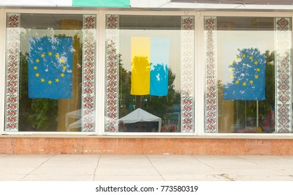 Flags of Ukraine, the European Union and national patterns of embroidery in the shop window