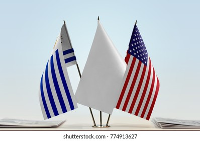 Flags of Uruguay and USA with a white flag in the middle