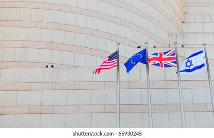 Flags US, UK, EU and Israel in Front of the Granite Facade