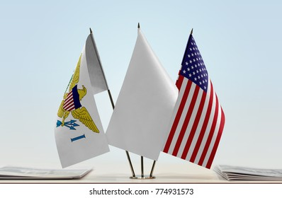 Flags of U.S. Virgin Islands and USA with a white flag in the middle