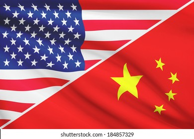 Flags of USA and China blowing in the wind. Part of a series.