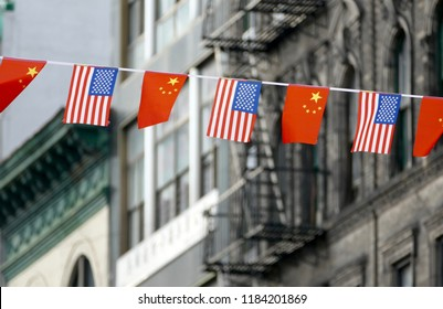 Flags of USA and China Hanging Next to Each Other in Chinatown, New York, USA