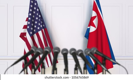 Flags of the USA and North Korea at international meeting or conference. 3D rendering