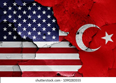 flags of USA and Turkey  painted on cracked wall