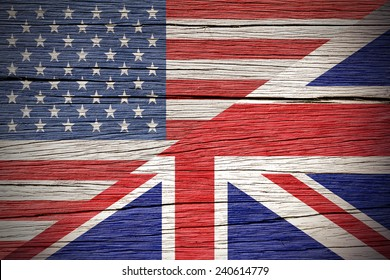 Flags of USA and United Kingdom over a Wooden Background