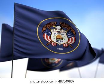 flags of Utah on blue sky background
