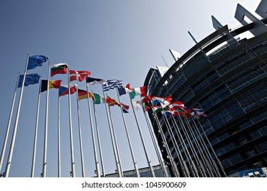 Flags wave outside of the European Parliament in Strasbourg, France on Feb. 13, 2017