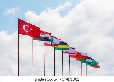 Flags. Waving Flag of 10 Countries with blue sky background.