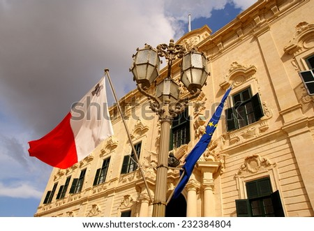Flags waving in front of  the building of Palace  of the Prime Minister in Valletta, Island of Malta