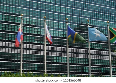 flags waving outside united nations building in manhattan new york