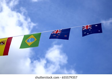 Flags of the world blowing in the breeze on a warm sunny spring day