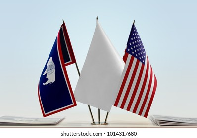 Flags of Wyoming and USA with a white flag in the middle