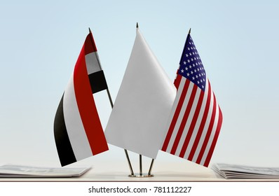 Flags of Yemen and USA with a white flag in the middle