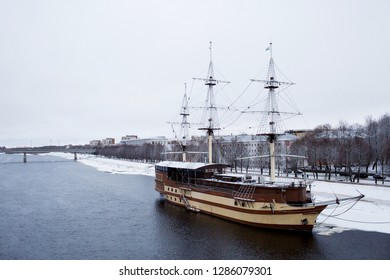 The flagship frigate, the restaurant on the waterfront in the winter cloudy day. View from the bridge. Veliky Novgorod, February 2018