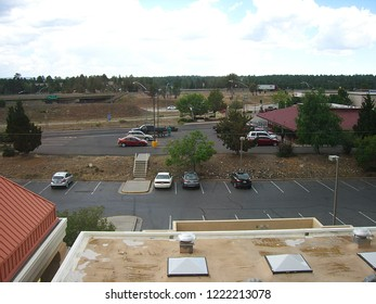 FLAGSTAFF, ARIZONA – JUNE 27: Early afternoon motel parking lots before the night`s guests arrive on June 27, 2012 in Flagstaff, Arizona. The city is surrounded by mountains, desert and ponderosa.