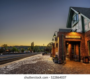 FLAGSTAFF, ARIZONA, USA - MAY 16, 2016 : Historic train station in Flagstaff at sunset. It is located on Route 66 and is formerly known as Atchison, Topeka and Santa Fe Railway depot. Hdr processed.