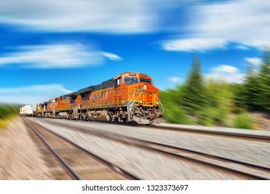 Flagstaff, Arizona, USA - September 22, 2018:  Freight train BNSF Railway Companies on a sunny day in Arizona. Motion.