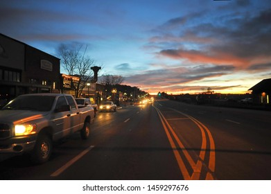 FLAGSTAFF, AZ / USA - DECEMBER 15 2010: Early morning traffic on historic Route 66 drive by the Flagstaff Amtrak station at N Leroux St in downtown Flagstaff.