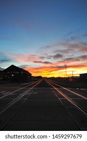 FLAGSTAFF, AZ / USA - DECEMBER 15 2010: Parallel train tracks extend nearly to the horizon by the Flagstaff Amtrak station on Route 66 in downtown Flagstaff, at dawn.
