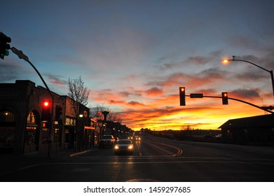 "FLAGSTAFF, AZ / USA - DECEMBER 15 2010: Autos stopped at the traffic light on Route 66, ""the Mother Road"", and S San Francisco St in downtown Flagstaff, at dawn."