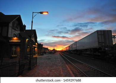 FLAGSTAFF, AZ / USA - DECEMBER 15 2010: At dawn, a BNSF freight train zooms by the Flagstaff Amtrak station on Route 66 in downtown Flagstaff.