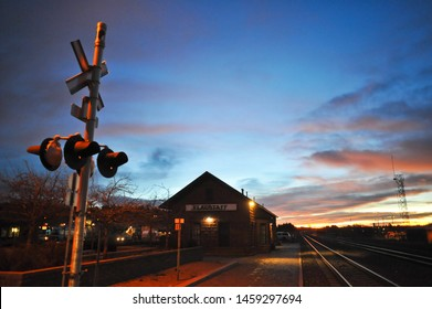 FLAGSTAFF, AZ / USA - DECEMBER 15 2010: The sun rises early in the morning at the S Beaver St railroad crossing near the Flagstaff Amtrak station on Route 66 in downtown Flagstaff,