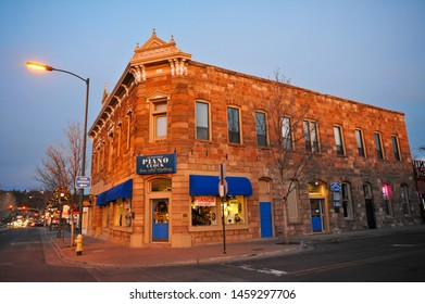 "FLAGSTAFF, AZ / USA - DECEMBER 15 2010: ""Flagstaff Piano Clock and Fine Art Gallery"" occupies the historic McMillan Building, built in 1886 as a bank and hotel, at 2 W Route 66 and N Leroux St"